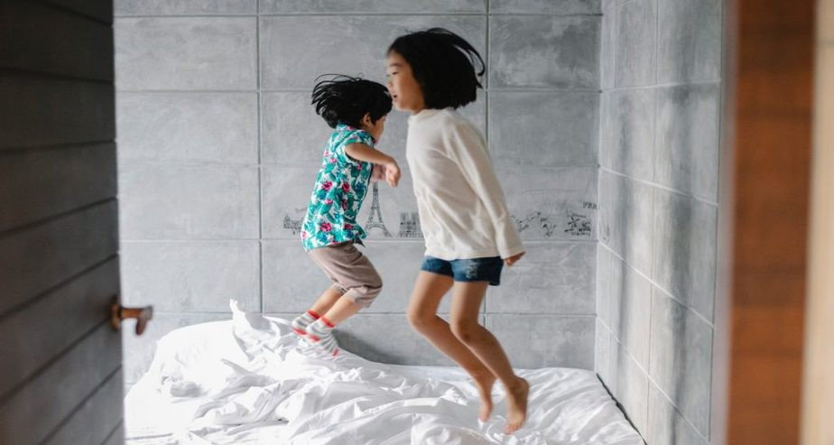 Kids Jumping In Bed